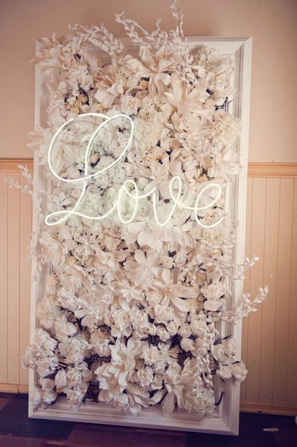 Flower Wall with a Neon Sign | Ted and Li Photography on @weddingweekly