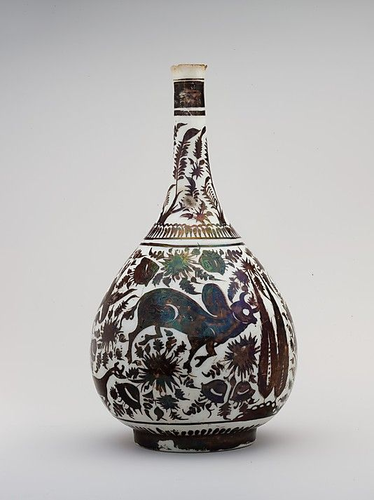 Pear-Shaped Bottle with a Bullock Design Object Name: Bottle Date: second half 17th century Geography: Iran Medium: Stonepaste; luster-painted on opaque white glaze Dimensions: H. 10 in. (25.4 cm) Classification: Ceramics