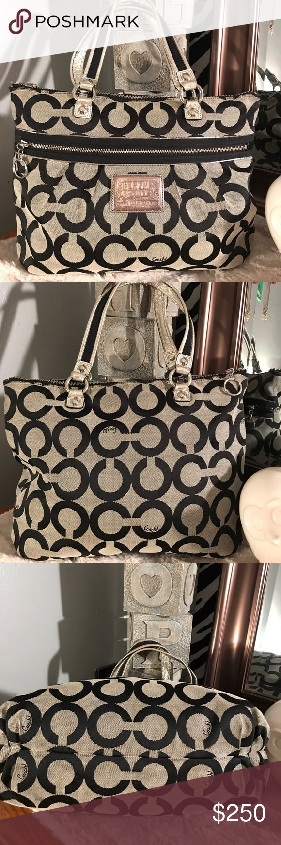 """Authentic coach large tote Very large authentic coach poppy tote with signature C logo print in black and gray with silver accents. Front of purse has one large zipper pocket. Inside of bag has one zipper pocket and a couple pockets to contain accessories. Outside of bag is in perfect condition no rips tears stains or holes and handles are in perfect condition. Inside of bag does show some signs of spots. Price Will be adjusted accordingly! Measurements are 15 """" across by 13""""high and 6""""…"""