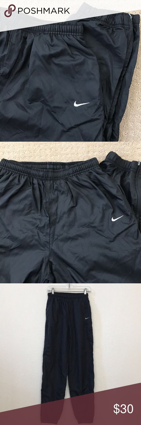 EUC Nike Training pants w ankle zippers ladies L Classic black Nike Training pants in ladies large (12-14), excellent preloved condition. Features cozily lined slit pockets & zippered ankles for easy on&off (built for serious athletes who don't have time to remove their shoes &/or for lazy days😂). Waistband is elasticized with drawstring to further customize your fit.  Material is a windbreaker-like 100% nylon exterior & heather gray t-shirt like cotton/polyester liner to zippered ankle…