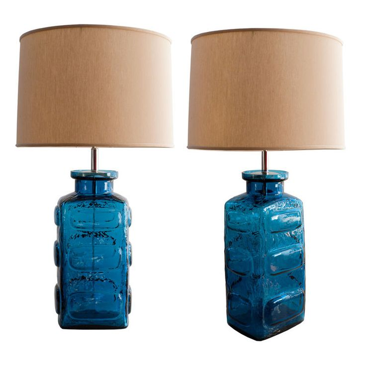 Pair of vivid blue glass table lamps by Pukeberg, Sweden 1960's | From a unique collection of antique and modern table lamps at https://www.1stdibs.com/furniture/lighting/table-lamps/