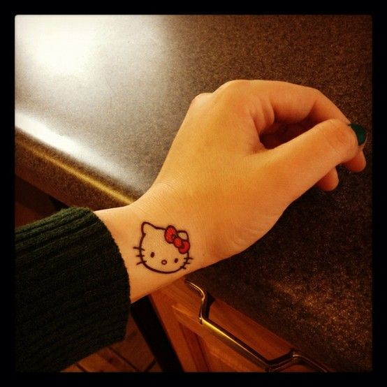 hello kitty tattoo -- I know someone who'd love this!