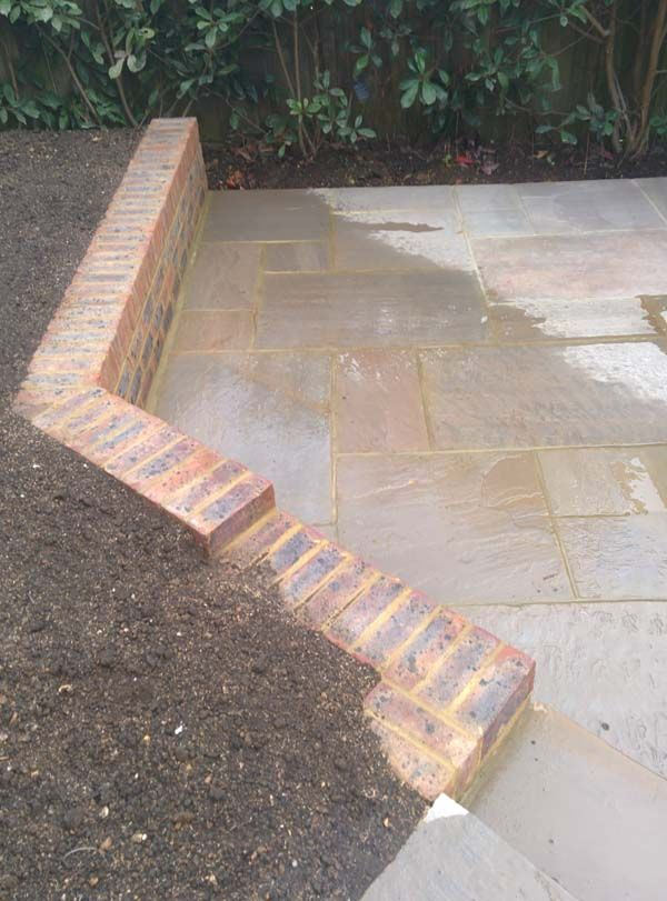 low brick walling and patio