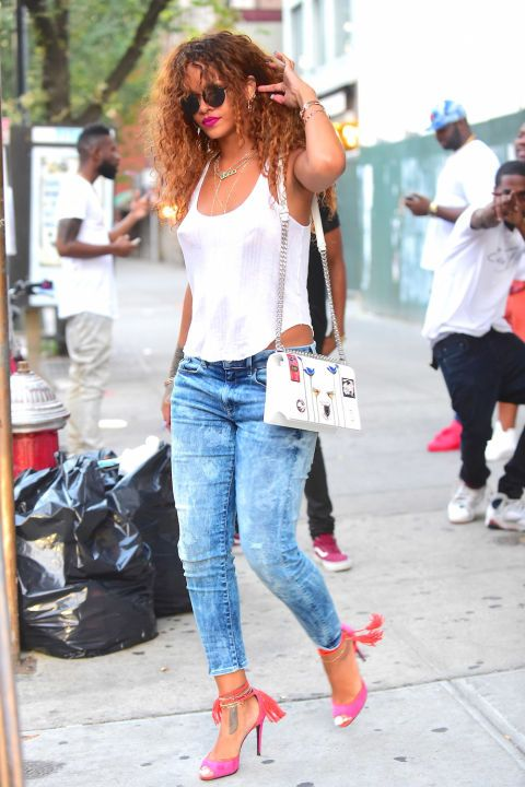 73 photos of the best celebrity street style: Rihanna in hot pink tasseled heels.