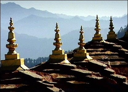 The kingdom of Bhutan.  They measure wealth in terms of happiness.  Literally - Gross National Happiness!  :-)
