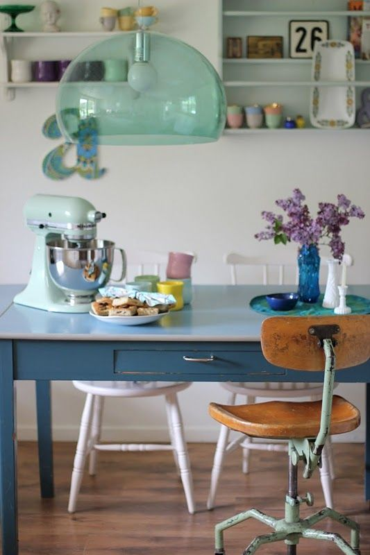 Like the casual mix and match of the vintage furniture.  Hint of #duckegg in the kartell light fitting & mixer
