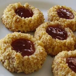 Thumbprint Cookies I With Butter, Brown Sugar, Eggs, Vanilla Extract, All-purpose Flour, Chopped Walnuts, Jam, Salt