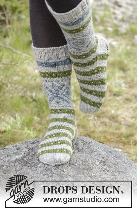 Nova Scotia Toes - Knitted socks with multi-coloured Norwegian pattern. Size 35 to 46 Piece is knitted in DROPS Karisma. Free knitted pattern DROPS 180-23