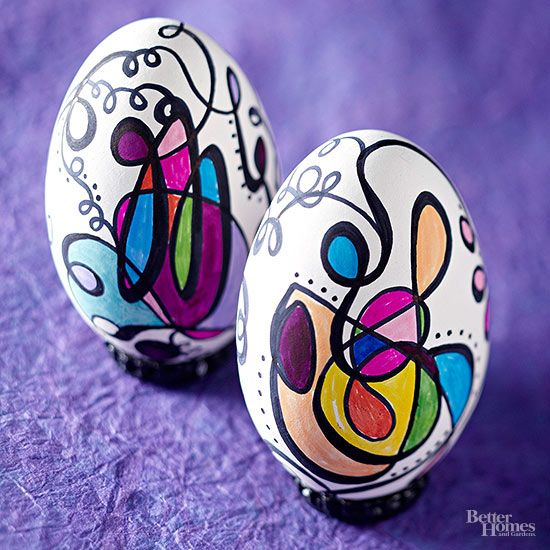 With a white hard-boiled egg as your canvas, you can inspire your inner artist and create a mini masterpiece. Use a medium-tipblack permanent marker to doodle curlicue lines, broadening a few of the strokes. Fill in your design with colored permanent markers, and finish with polka dots that follow the curves of the lines.