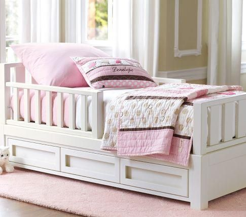 an adorable white girls toddler bed with storage drawers from pottery barn kids i love the penelope toddler bedding
