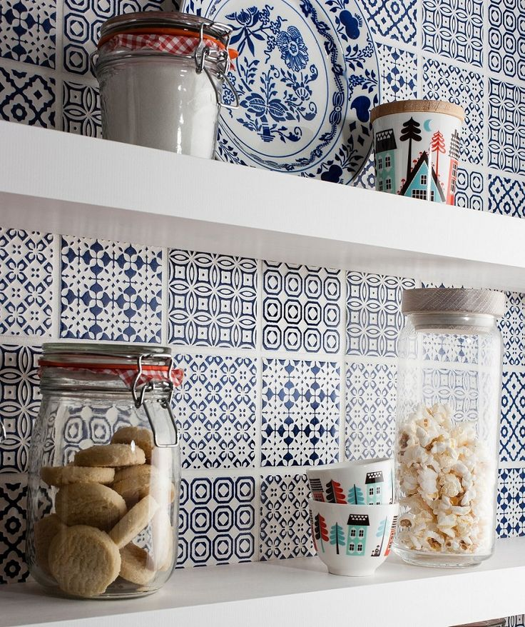 Use different patterned tile in the same colours to create a fun patchwork backsplash. #kitchens #backsplash #tile