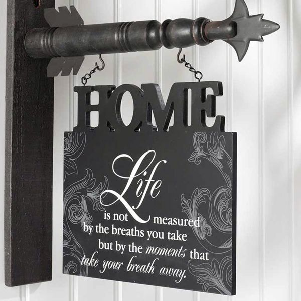 """This seasonal hanger has the beautiful saying, """"Life is not measured by the breaths you take but by the moments that take your breath away."""""""