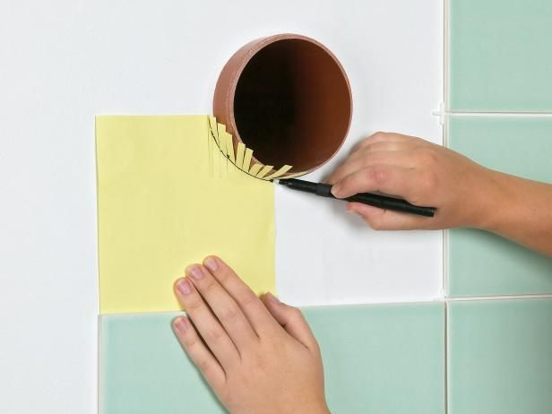 DIYNetwork.com has easy step-by-step instructions on how to properly measure and cut curves and holes in tile. Plus, find out how to lay tile in a diamond pattern and how to create borders.