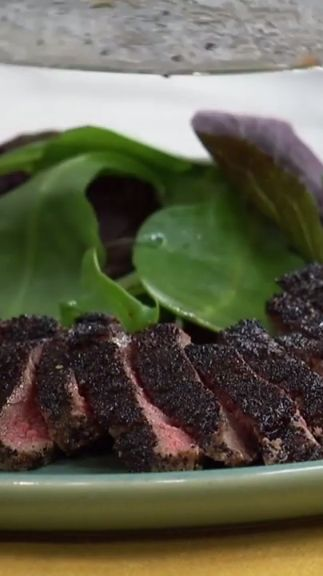 Jeff creates a peppery dry rub with coffee grounds and peppercorns for his New York strip steaks!
