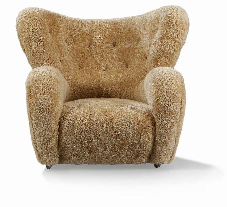 The Tired Man Easychair, upholstered with light brown sheepskin, A. J. Iversen. Flemming Lassen.
