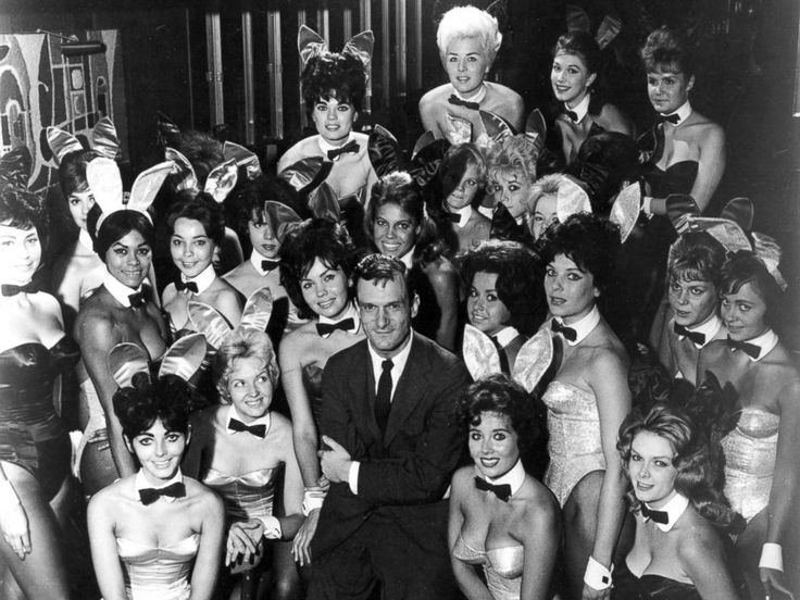 PHOTO: Hugh Hefner poses with Playboy Bunnies at one of the early Playboy Clubs, in 1962.