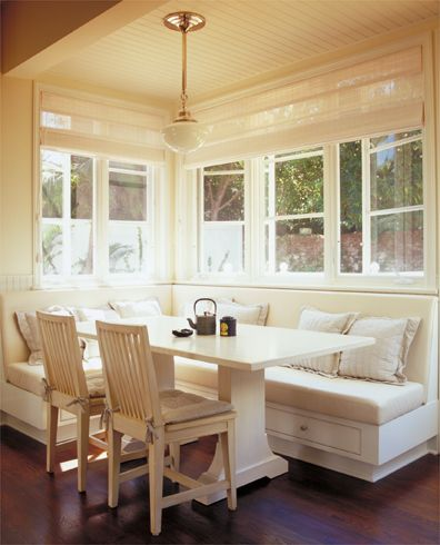 Nice built in-bench with creamy white and neutrals. Beautiful natural light coming in.