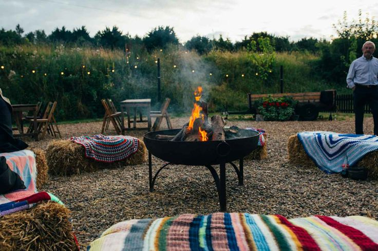 Fire pit and strawbales with crocheted blankets for a Summer Wedding at The Keeper and the Dell, Norfolk Indie Outdoorsy Camp Wedding http://emilytylerphotography.com/