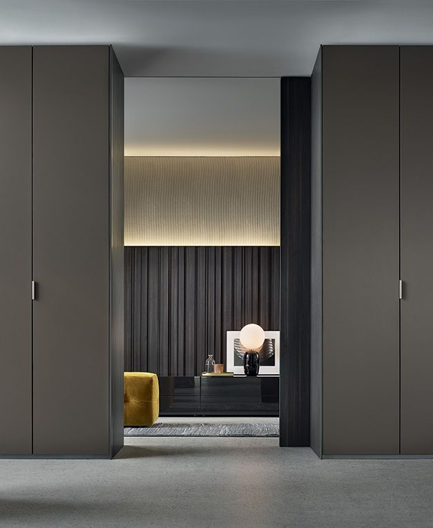 Senzafine Fitted wardrobes, leaf opening, visone mat lacquered doors with frame in piombo painted aluminium.