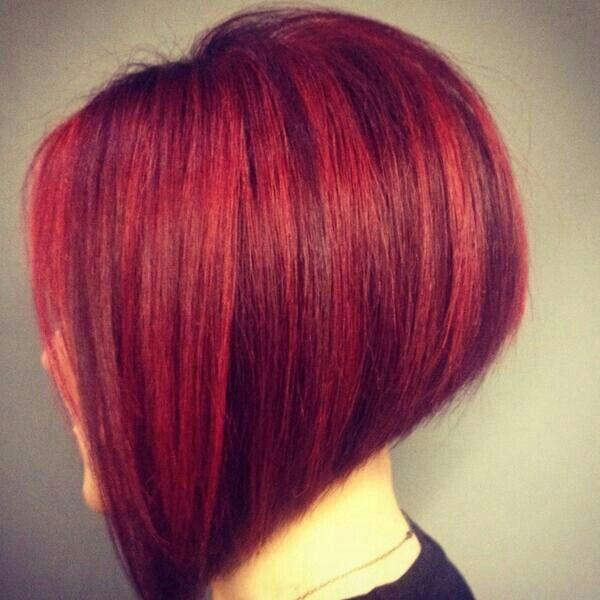 Red hair with Red Violet highlights.  Now as you all know I am not a fan of Stripes in hair.  This is a tremendous example of a perfect marriage of haircut and colour.   Cheers to the stylist that created this.  I'm sooooo copying it!!! Lol