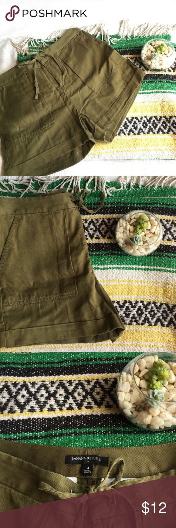 Army Green Shorts Channel your in er safari guide in this pair of adorable army green shorts. High waisted, deep front pockets, drawstring waist, cuffed, super silky material! *Factory Item* Banana Republic Shorts