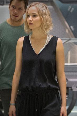 Jennifer Lawrence wearing Melissa Odabash Zuma Swimsuit and Frame Silk Jumpsuit