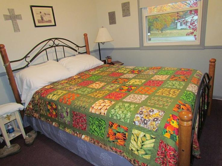 Patchwork Queen Size Quilt - love the colours in this quilt and the green borders really pull it together.