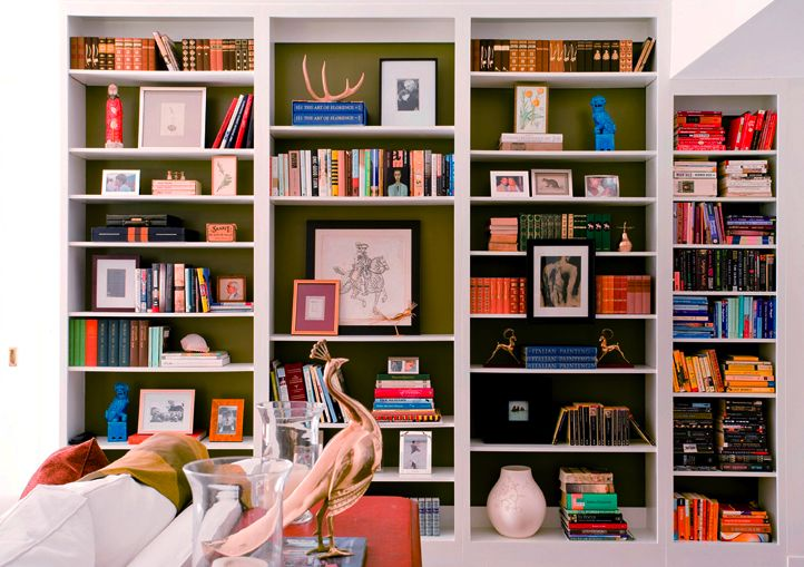Painted bookshelves. Repetition; not overloading; coloured backing.  (via 2M Designs Interiors)