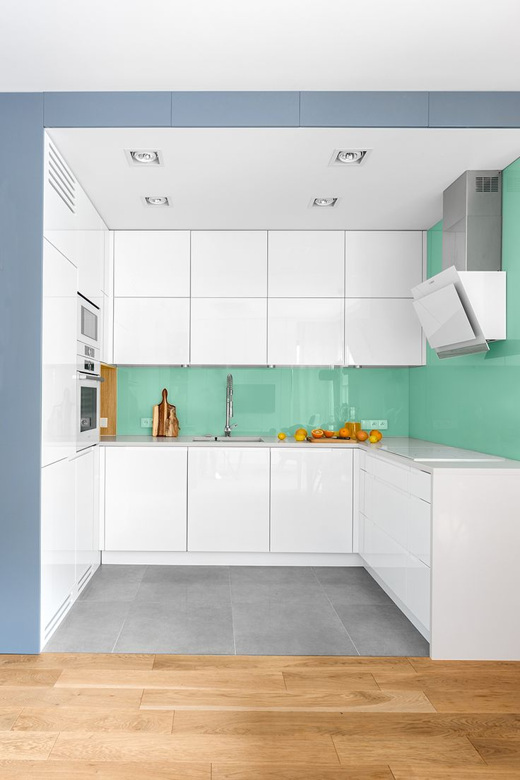 White kitchen with mint glass and blue-gray.