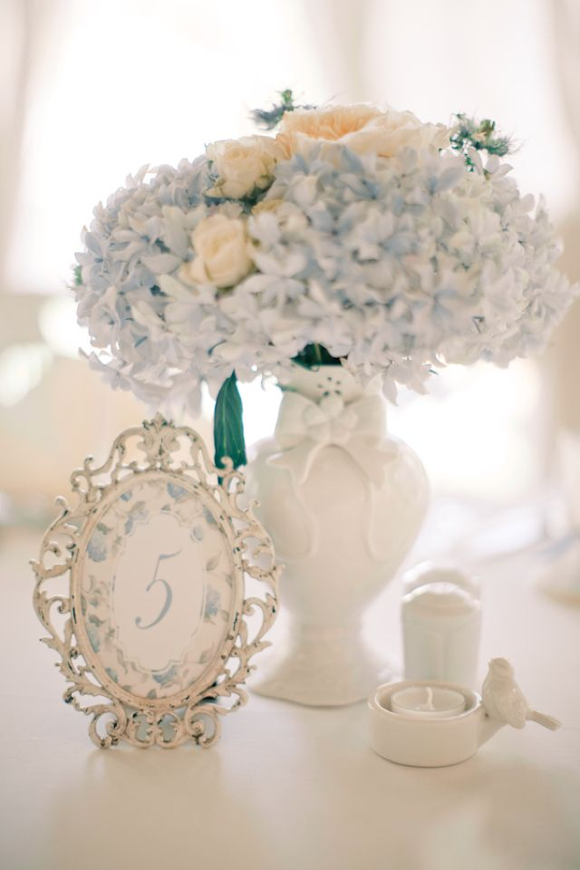 Powder blue hydrangea centerpiece and table number | Anastasiya Belik Photography | http://burnettsboards.com/2013/12/powder-blue-white-wedding/