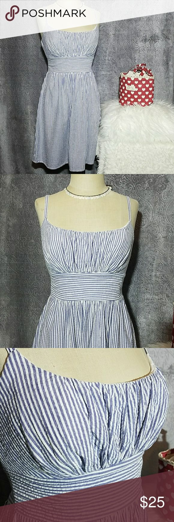 B. Smart sear sucker striped dress 8 Blue and white pin striped sear sucker, adjustable straps, lighted padded and lined chest. 100% cotton. Great condition.  Size 8 B.Smart Dresses Midi