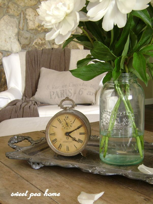 Tarnished Silver tray, old alarm clock, old jar with white flowers...beautiful.