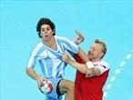 Diego Esteban Simonet of Argentina gets put under pressure in the men's Handball preliminaries