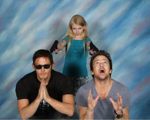 Addy Miller - the little zombie girl from the gas station in the first episode of The Walking Dead - pointing guns at Norman Reedus and Sean Patrick Flanery. The awesomeness is like a punch in the face.