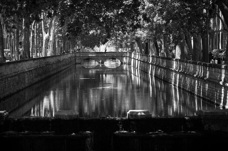 A river and bridge in central Nîmes, Languedoc-Roussillon region, France. - Don McCullin Feature