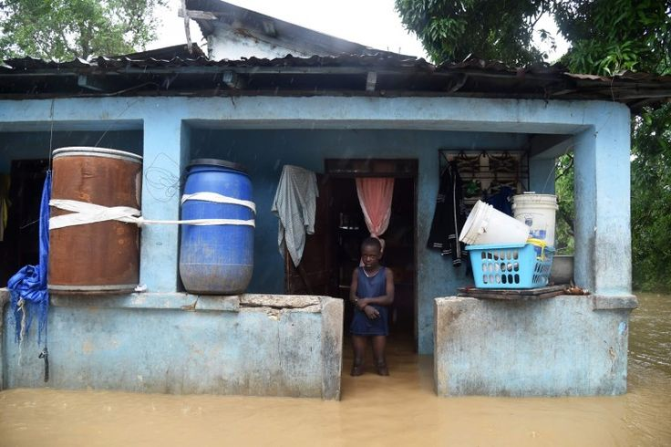 Franki stands in his flooded home following the overflowing of La Rouyonne river in the commune of Leogane, south of Port-au-Prince, October 5, 2016. Haiti and the eastern tip of Cuba -- blasted by Matthew on October 4, 2016 -- began the messy and probably grim task of assessing the storm's toll. Matthew hit them as a Category Four hurricane but has since been downgraded to three, on a scale of five, by the US National Hurricane Center. (Hector Retamal/AFP/Getty Images)