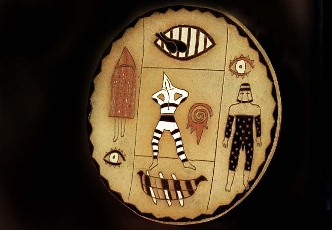 Ornamental stoneware plate, hand painted. Designs and figures of Selknam people. By Maggie Sierralta