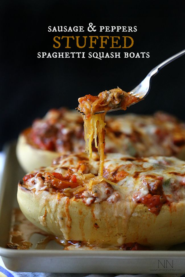 Sausage and Peppers Stuffed Spaghetti Squash: Sausage, peppers, onions and meat sauce all packed inside a roasted spaghetti squash and topped with lots of stringy cheese.