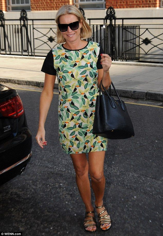 Leggy lady:Denise van Outen paraded her toned and tanned legs in a summer shift dress as ...