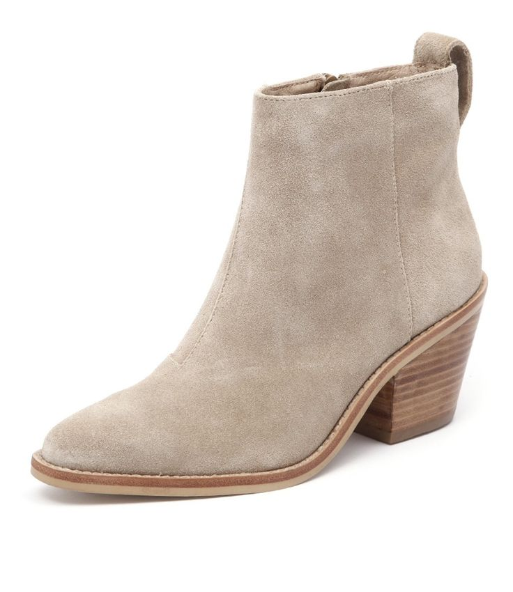 Go west! This leather ankle boot by EOS features an on trend cuban stacked heel…