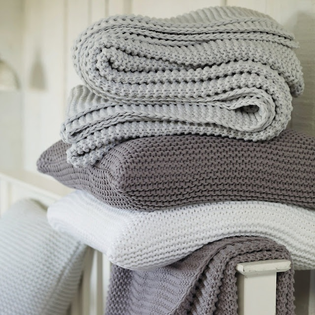 gorgeous dusted, chalky tones of duck egg blue, plum and white knitted throws by The White Company