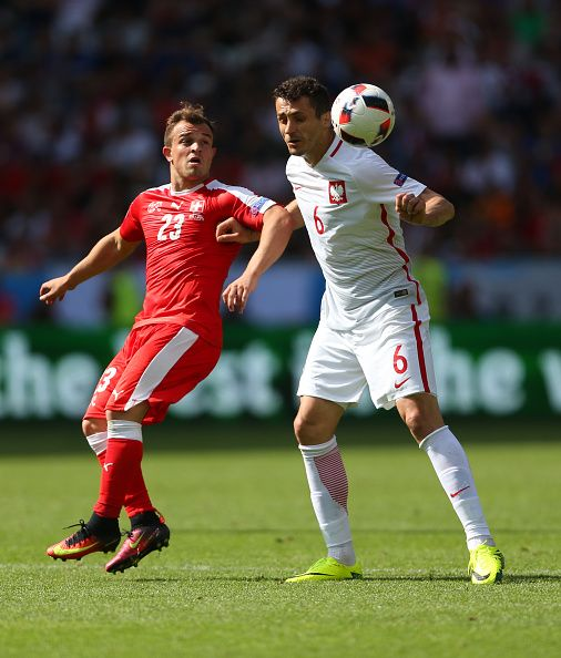 #EURO2016 Xherdan Shaqiri of Switzerland and Tomasz Jodlowiec of Poland during the UEFA EURO 2016 Round of 16 match between Switzerland v Poland at Stade...