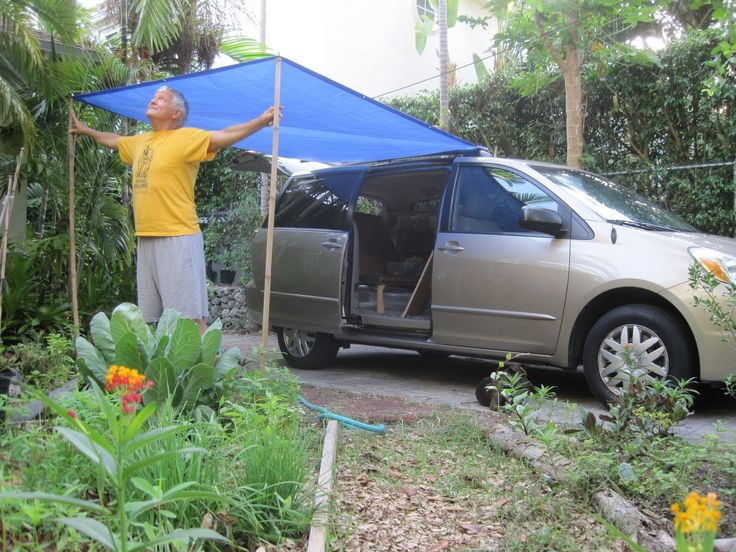 minivan camper conversion | little tarp and two bamboo sticks gave us a front porch.