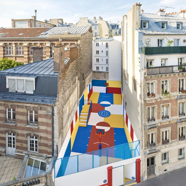 Even non-sports fans will appreciate this colorful basketball court tucked between two apartment building on the rue Duperré in the Paris's 9th arrondissement. | archdigest.com