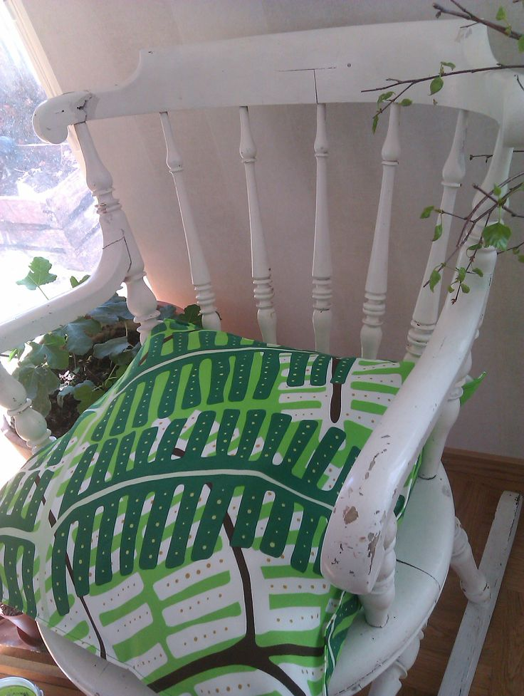 IKEA fabric green cushion covers for vintage rocking chair.