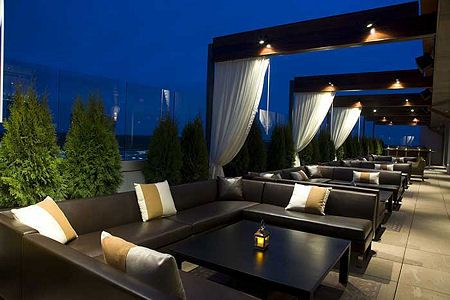 Hotel restaurants and clubs are out, swanky rooftop bars are in.