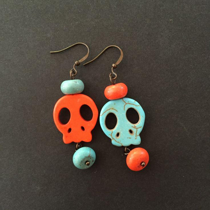 Fun Mismatched Orange and Turquoise blue dyed howlite skull earrings, wirework, day of the dead, rockabilly punk by GreenfishBluefish on Etsy