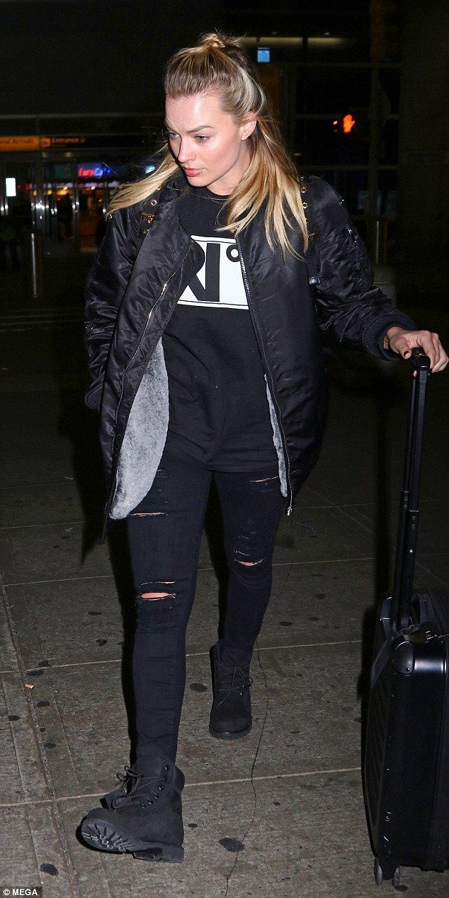 Rock chic: Margot Robbie channelled her inner rock chick in ripped denim and a bomber jack...