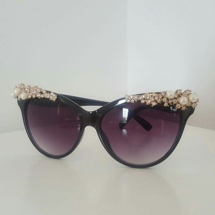 Sunglasses with gold jewelry. Classy