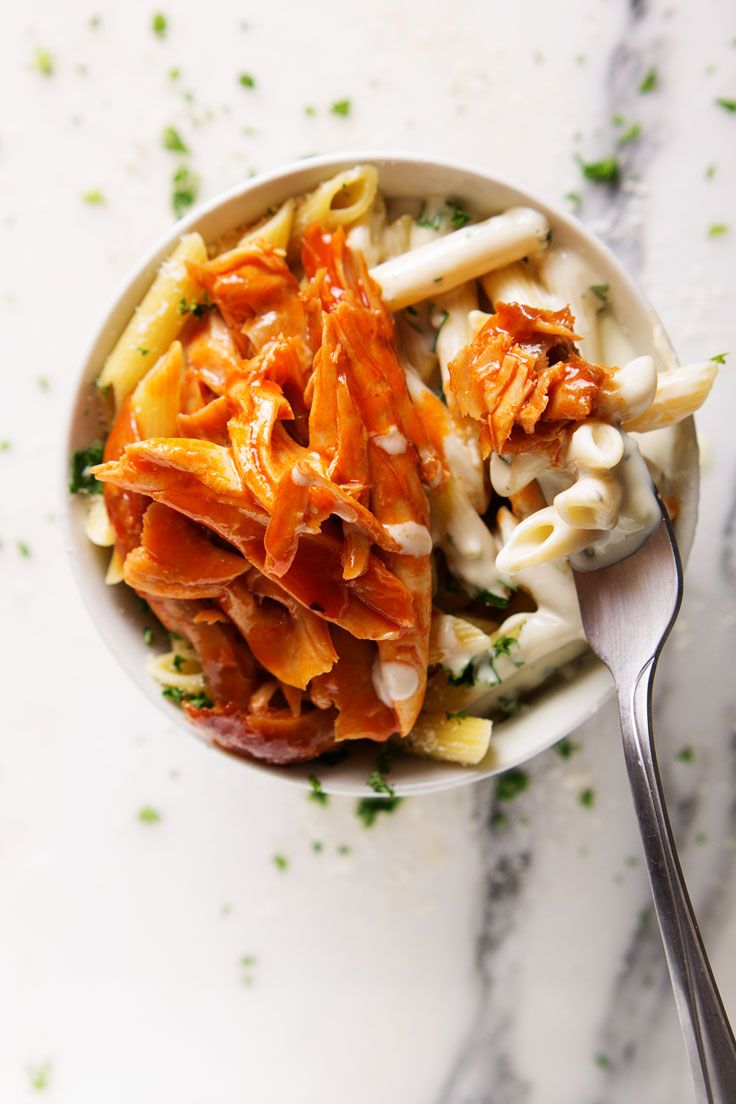 Buffalo Chicken Penne with Blue Cheese Alfredo Sauce - can be made with rotisserie chicken for a quick and easy meal. Perfect for hot wing lovers who hate the mess! #gameday